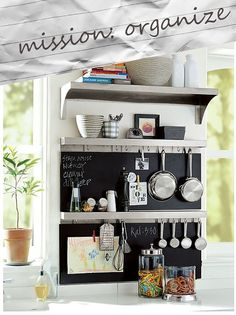 nice! chalkboard, shelves and pot rack in one