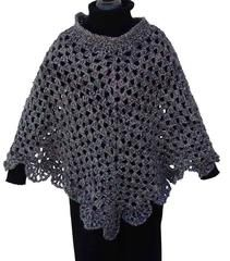 #FP145MARTHA'S COMING HOME PONCHO Skill Level: Easy Sizes: One Size Fits Most Adults Materials: Bulky Weight Yarn – 4 skeins Romanesque (MC) – 24 oz, 740 yds, (