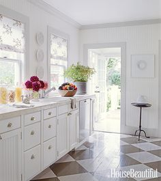 Checkerboard Floors-CHECKERBOARD FLOORS Designer Timothy Whealon refreshed existing beadboard cabinets with crisp white paint and animated the floor with a classic checkerboard.