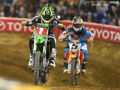 Villopoto attempts to hold off the home town favorite Ryan Dungey at Minneapolis.