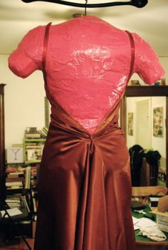 Etoiledunord created this how-to for creating a Duct Tape dress form, complete with silly pictures of her all mummified in neon pink Duct Tape! This has got to be one of our favorite DIY experiment...
