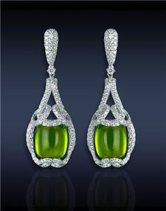 Pridot Drop Earrings, Featuring: 26.50cts Cushion Cabochon Peridot (2 Stones), Surrounded by 3.60cts Pave Set White Diamonds (392 Stones). - Jacob &Co. | Timepieces | Fine Jewelry | Engagement Rings