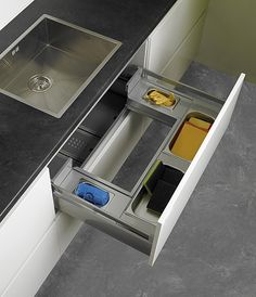 Love this idea of utility drawer under the sink