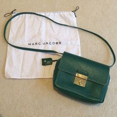 NWOT*Marc Jacobs Crossbody *PM Editor Share*2x Host Pick* Authentic. Never used. Marc Jacobs (not Marc by Marc Jacobs). Zipper closure plus a flap that folds over with a secure lock. Lock can be undone by pushing down or with the hidden key. Gold hardware. Strap is removable. Marc Jacobs Bags Crossbody Bags