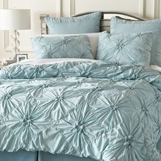 I love this bed comforter in soft shabby blue.