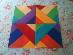 I like the solids! i did a quilt block like this RED,BLACK,BLUE.YELLOW for Pittsburg Steelers for a friend.