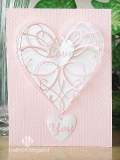Memory Box La Rue Heart and Elizabeth Craft dies used to make this pink and white pop-up Valentine's Day card.