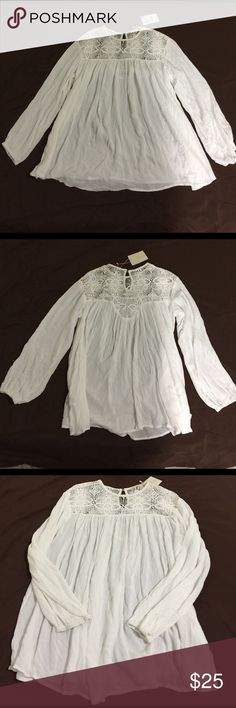 Zara White Flowy Tunic Top, size XS NWT Zara White Flowy Tunic Top in XS, NWT. Made from 100% viscose and the trim is 100% cotton. Features a flowy, gauzy, material with a beautiful crochet type trim, button closure in back, and long sleeves with elastic at the ends. Measures 20.5 from armpit to armpit and 27.25 from shoulder to hem. Can definitely fit a larger size. Please ask if you have any questions. Zara Tops Tunics