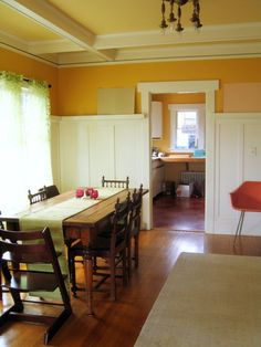 walnut stokke chair, farm table, orange wall, high board n batton. clean, simple, warm, like it!