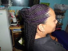 Ghana cornrow with senegelese twist at the end .