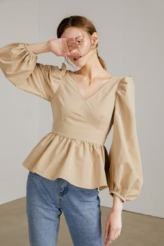 Light tan peplum blouse with v-neck collar, puffed shoulders, long peasant sleeves and flounced bottom half for a feminine and romantic feel. Fast Fashion, Trendy Fashion, Classy Outfits, Casual Outfits, Hijab Fashion, Fashion Outfits, Sleeves Designs For Dresses, Crop Top Outfits, Fashion Sewing