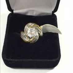 Beautiful GP CZ Ring Unique design, very pretty. Gold plated, CZ ring size 6. Jewelry Rings