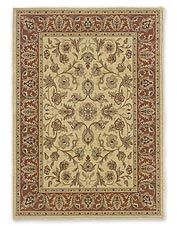 This appealing wool border area rug imparts a refined look to any interior space.