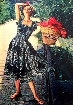 Dorian Leigh in a summer dress as seen in Elle, 1950