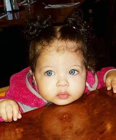 Beautiful baby girl with mesmerizing blue eyes