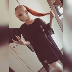 young woman with long red hair and shaved sides Shaved Undercut, Shaved Nape, Shaved Sides, Long Undercut, Shaved Heads, Half Shaved Head Hairstyle, Mullet Hairstyle, Shaved Hair Women, Shaved Hair Cuts
