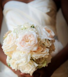 Beautiful light peach and ivory bridal bouquet. South Africa wedding planned by Wedding Concepts | via junebugweddings.com