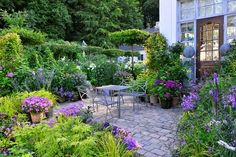 Beautiful patio with lots of lovely pots.