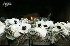Winter Medieval Wedding shoot at the Outing Lodge in Stillwater.  Black and white anemone centerpiece with gray barn wood.  Image by Studio Laguna Photography