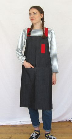Super comfortable crossback apron - crisp heavy-weight charcoal denim - red straps and pencil pocket. Artist/maker's work apron, with no ties around the neck, or dangly ties coming undone when your hands are completely covered in 'muckiness'!