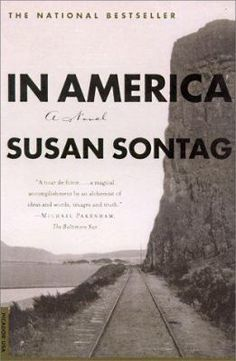 """""""In America"""" is a kaleidoscopic portrait of America on the cusp of modernity. As she did in her enormously popular novel """"The Volcano Lover,"""" Susan Sontag casts a story located in the past in a fresh, provocative light to create a fictional world full of contemporary resonance. In 1876 a group of Poles led by Maryna Zalezowska, Poland's greatest actress, emigrate to the United States and travel to California to found a """"utopian commune."""" When the commune fails, Maryna stays, learns English…"""