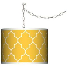 "Swag Style Tangier Yellow Shade Plug-In Chandelier | Add instant style and glamour with this swag chandelier. Plug the light into any standard wall outlet, then hang the cord on included the swag hooks. Drape the cord as desired. The lamp features a brushed silver finish spider fitting and a silver cord. In-line on-off switch controls the lights. Includes swag hooks and mounting hardware.  Includes swag hooks and mounting hardware.  100 watt bulb. 10"" high. 13 1/2"" wide.  15 feet of lead…"