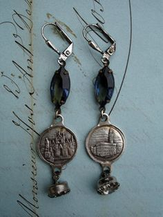 """Blue Florence Italy Vintage Repurposed Button Earrings  From silverplate leverback earrings hang vintage Montana blue marquis-shaped faceted glass connector; links from a vintage Florence (Firenze), Italy, souvenir bracelet - fronts have landmarks and the back has the Fleur de Lis symbol of Florence and """"Firenze""""; vintage faceted glass buttons dangle from the bottom..."""