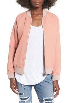 Heading back to school in this trendy bomber jacket in the perfect shade of blush pink and finished with scrolling embroidery at the back.
