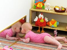 PLAYROOM IDEA--A mirror along the bottom of the wall so that a baby or young child playing in the room can see themselves when they are crawling or playing with toys along the floor.
