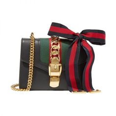 - A structured cross-body exceeds expectationsin a mini silhouette with charming accents.