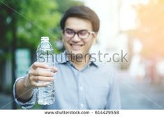 Young man drinking water from the bottle.