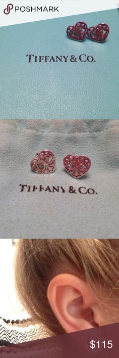 Tiffany & Co. Enchant Collection Heart Earrings The scrolled iron gates of opulent estates and secret gardens inspired this ornate collection. Fanciful curves create these dynamic yet dainty heart earrings. Sterling silver. Comes with original Tiffany & Co. jewelry bag and box. In excellent condition! Please feel free to ask me any questions, and check out the matching Enchant Ring I posted! I offer 20% off bundle! Tiffany & Co. Jewelry Earrings