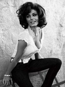 Iconic Italian actress brunette Sophia Loren in white blouse and black pants