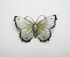 Antique English Silver Butterfly Brooch by Charles Horner,  with Green, white and black enamel. 1916