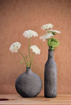 How to Turn Glass Bottles into Cement Vases (The Easy Way!) easy diy decor hand formed cement over glass vases, concrete masonry, home decor, repurposing upcycling, These vases were made with the thick mix Diy Simple, Easy Diy, Concrete Crafts, Plaster Crafts, Deco Floral, Wedding Table Centerpieces, Table Wedding, Easy Home Decor, Flower Vases