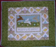 Hoppy Easter mini quilt. The little eggs and chicks sit in pockets.