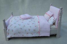Pink dollhouse bed made by Jolanda Knoop