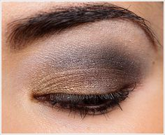 golden, brown and black eye makeup