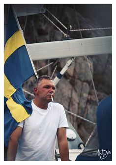 Snipershot of unknown man on his boat. What captures me is his complete focus; he didn't even flinch when the wind wrapped the flag over his shoulder. Photo by Måns Viktorson.