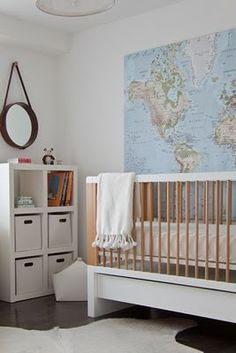 Another take on travel theme, with large colorful map.  Could use stickers to track baby's travels.  Large map is available at Ikea.