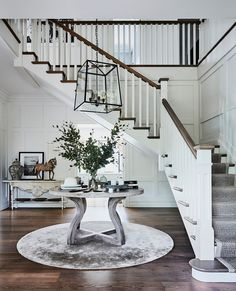 """Homes To Love on Instagram: """"The interior of the circa-1910 house was very dated, with a palette that included creamy yellow walls, blue floor tiles and lots of chintz…"""" Blue Floor, Yellow Walls, Splashback, Grand Entrance, Tiles, Stairs, Palette, Dining Table, Interior"""