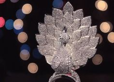 Behold the glory of this unique 'Peacock Ring' set in gold with 3827 diamonds mounted on it as it earns a spot in the Guinness Book of Records, designed by Savio jewellery that was unveiled yesterday. Peacock Ring, Guinness Book, Jaipur, 18k Gold, Diamonds, Jewellery, Unique, Rings, Design