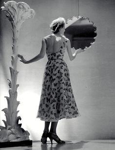 Elsa Schiaparelli Evening Dress For summer 1937, printed multicolored butterflies fluttered over pale pink silk organza.