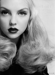 I dont love the hair but the make up is old hollywood style! Beautiful!
