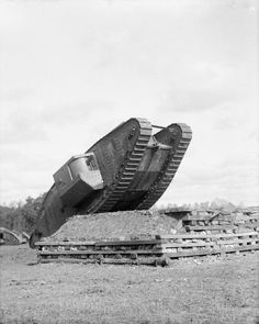 MINISTRY INFORMATION FIRST WORLD WAR OFFICIAL COLLECTION (Q 11696)   Mark IV Tank climbing a test ramp at the testing ground, Central Stores, Erin. September 1917.
