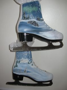 """$45 on etsy """"NORTHWOODS"""" - Ice Skates upcycled and handpainted by HandmadesbyJ, Seller states: """" Ice Skates, up-cycled and hand-painted entitled """"Northwoods""""! Northern Lights, wolf and rabbit depicted on Women's size 8 skates. These skates would make a charming addition to your porch or inside for winter decor. The skates are in excellent condition."""" - """"Painted with acrylics and sealed with an outdoor clear sealer, painted on one side of each skate"""""""