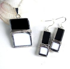 Classic Black and White Stained Glass Earrings - Jewelry Pendant - Wire Wrapped - Handmade  Handmade by me. This is a brand new design and is my original work. Absolutely gorgeous stained glass pendant that will definitely enhance any outfit. The hand cut black and white rectangular glass is soldered together and wire wrapped around the glass for a unique effect.. It comes ready to wear with a serpentine silver tone chain with a spring clasp and hand polished to a brilliant silvery shine…