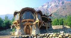 """Or, if you don't want a """"tiny home"""" you can """"go big, or go home"""" by building an incredible roundwood-framed, stone, glass behemoth in a mountain valley. Since some of these photos are meant for inspiration and whimsy (and are not actual construction suggestions) I want to let you know that I don't have any information about this picture, it came from a friends page, so if anyone has additional credits or links, please """"lay them on me."""""""