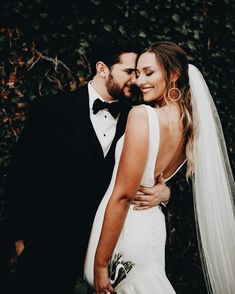 bride and groom | classic black and white tuxedo with bow tie | low back white wedding gown | more wedding inspo @danellesbridal danellesboutique.com