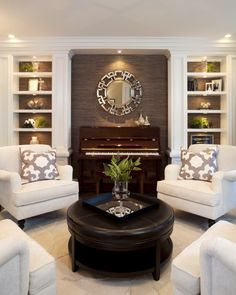 Interesting.......If your living room area is small, placing club chairs in a circle is a great way to utilize and maximize the space. Formal living inspiration